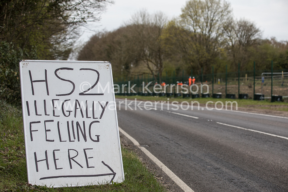 A sign outside Stop HS2's Wendover Active Resistance Camp indicating a site on the opposite side of the A413 currently being cleared of trees and vegetation by contractors working on the HS2 high-speed rail link is pictured on 9th April 2021 in Wendover, United Kingdom. Tree felling work for the project is now taking place at several locations between Great Missenden and Wendover in the Chilterns AONB, including at Jones Hill Wood.