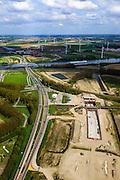 Nederland, Zeeland, Zeeuws-Vlaanderen, 09-05-2013; Sluiskil, Kanaal Gent-Terneuzen, kanaalkruising Sluiskil. Bouwput van de tunnel in aanbouw.<br /> De brug in de N61 sluit zeer regelmatig voor zeeschepen en dit veroorzaakt files. Daarom zal de kanaalbrug vervangen worden door een tunnel, de Sluiskiltunnel (oplevering 2015).<br /> The pivot bridge over the canal Gent-Terneuzen (Zeeland) closes very regularly for seagoing vessels and this causes traffic jams. Therefore, the canal bridge will be replaced by a tunnel, the tunnel Sluiskil (completion 2015).<br /> luchtfoto (toeslag op standard tarieven);<br /> aerial photo (additional fee required);<br /> copyright foto/photo Siebe Swart.
