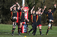 Wales players stretch and warm up during the Wales rugby team training at the Vale Resort, Hensol near Cardiff, South Wales on Wed 24th February 2016. The team are preparing for the the RBS Six nations championship match against France on Friday night.<br /> pic by  Andrew Orchard, Andrew Orchard sports photography.