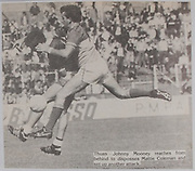 Johnny Mooney reaches from behind to disposses Mattie Coleman and set up another attack,