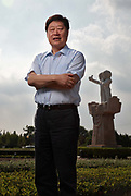 Zhang Ruimin, chief executive officer of Haier Group, poses for photographs out side of the company's head quarters in Qingdao, Shandong Province, China on 25 August 2011.  Haier is the largest white goods manufacturer in the world.