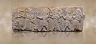 Aslantepe Hittite relief sculpted orthostat stone panel. Limestone, Aslantepe, Malatya, 1200-700 B.C. . Anatolian Civilisations Museum, Ankara, Turkey<br /> <br /> Scene of the king's offering drink and sacrifice to the gods. King pours from the pitcher to the vessel (libation); behind the king is a servant bringing a sacrifice. Storm God across the king holds Teshup, a triple lightning bundle - sickle, and a spear-mace set in the other orthostat; the goddess Ishtar holds weapon in both. All six figures have shoes with the curled ends. <br /> <br /> Against a brown art background.<br /> <br /> If you prefer to buy from our ALAMY STOCK LIBRARY page at https://www.alamy.com/portfolio/paul-williams-funkystock/hittite-art-antiquities.html . Type - Aslantepe - in LOWER SEARCH WITHIN GALLERY box. Refine search by adding background colour, place, museum etc.<br /> <br /> Visit our HITTITE PHOTO COLLECTIONS for more photos to download or buy as wall art prints https://funkystock.photoshelter.com/gallery-collection/The-Hittites-Art-Artefacts-Antiquities-Historic-Sites-Pictures-Images-of/C0000NUBSMhSc3Oo