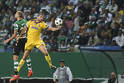 October 31, 2017 - Lisbon, Portugal - Juventus's defender Andrea Barzagli (R) vies wirth Sporting's forward Bas Dost during the Champions League  football match between Sporting CP and Juventus FC at Jose Alvalade  Stadium in Lisbon on October 31, 2017. (Credit Image: © Carlos Costa/NurPhoto via ZUMA Press)