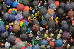 South America, Ecuador, Pinchincha Province, Quito.  Sea of umbrellas viewed from above; procession during Holy Week (Semana Santa) on Good Friday.