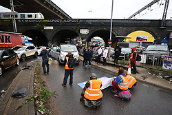 © Licensed to London News Pictures. 01/10/2021. London, UK. Climate protest group Insulate Britain block the M1 at the junction with the North Circular at Staples Corner in North London. Insulate Britain have successfully blocked various roads around the capital over a number of weeks, resulting in a court injunction banning them from going near the M25 motorway. Photo credit: Ben Cawthra/LNP