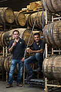 Virag Saksena (left) and Vishal Gauri pose for a portrait at 10th Street Distillery in San Jose, California, on September 4, 2019. (Stan Olszewski for Content Magazine)