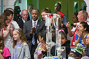 Former Neurosurgeon and Republican presidential candidate Dr. Ben Carson enjoys Christmas carols with patients during a visit to the MUSC Children's Hospital December 22, 2015 in Charleston, South Carolina. Carson stopped by to listen to Christmas carols and greet the young patients.
