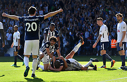 West Bromwich Albion's Jake Livermore (centre bottom) celebrates scoring his side's first goal of the game with team mates during the Premier League match at The Hawthorns, West Bromwich.