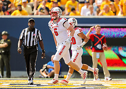 Sep 14, 2019; Morgantown, WV, USA; North Carolina State Wolfpack tight end Cary Angeline (6) celebrates after catching a touchdown pass during the second quarter against the West Virginia Mountaineers at Mountaineer Field at Milan Puskar Stadium. Mandatory Credit: Ben Queen-USA TODAY Sports