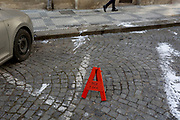 A motorist's A sign tells others he intends to return in an hour in Holesovice district, Prague 7, on 20th March, 2018, in Prague, the Czech Republic.