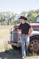 hot cowboy leaning against a vintage truck