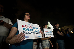 July 27, 2017 - Washington, District Of Columbia, U.S. - SANDRA HERNANDEZ of Brooklyn, NY holds a ''Don't Take Away Our Health Care'' protest sign outside the U.S. Capitol as the senate votes on a 'Skinny Repeal' of the Affordable Care Act inside. (Credit Image: © Alex Edelman via ZUMA Wire)