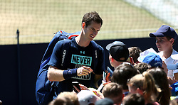 Great Britain's Andy Murray signs autographs for fans during day three of the Nature Valley International at Devonshire Park, Eastbourne.
