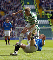 Photo. Glyn Thomas. <br /> Glasgow Celtic v Glasgow Rangers. <br /> Scottish Premier League. 29/08/2004.<br /> Celtic's new signing Juninho is brought down by Rangers' Gregory Vignal (R)