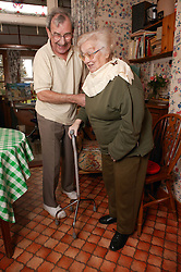Couple in their home receiving homecare for the elderly,