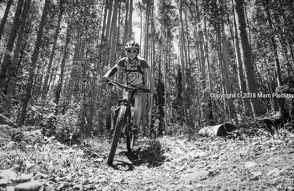 SHOT 6/10/18 12:02:14 PM - Vesta Lingvyte of Denver, Co. mountain bikes the Colorado Trail near Granite, Colorado. The Colorado Trail is a long-distance trail running for 486 miles (782 km) from the mouth of Waterton Canyon southwest of Denver to Durango in Colorado, United States. Its highest point is 13,271 feet (4,045 m) above sea level, and most of the trail is above 10,000 feet (3,000 m). Despite its high elevation, the trail often dips below the alpine timberline to provide refuge from the exposed, storm-prone regions above. (Photo by Marc Piscotty / © 2018)