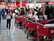 """25 NOVEMBER 2011 - PHOENIX, AZ:   The line to reach the checkout counters in the Target Store across the street from Paradise Valley Mall Friday morning. """"Black Friday,"""" the unofficial start of the holiday shopping season started even earlier than normal. Many stores, including Target and Best Buy, opened at midnight. The end of the line was marked by a person holding a large sign.        Photo by Jack Kurtz"""