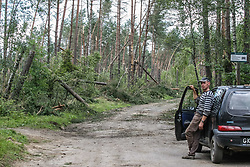August 14, 2017 - Sylczno, Poland - Man looking at the fallen trees in the forest are seen near the Sylczno village , northern Poland on 14 August 2017  Storms which on Friday 11th, August night and Saturday morning swept roughie the country killed six people and damaged thousands of houses. Thirty thousand hectares of forest were also destroyed. (Credit Image: © Michal Fludra/NurPhoto via ZUMA Press)