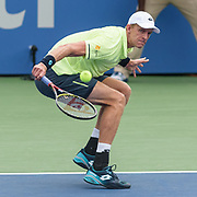 KEVIN ANDERSON hits a slice backhand during his match on day four at the Citi Open at the Rock Creek Park Tennis Center in Washington, D.C.