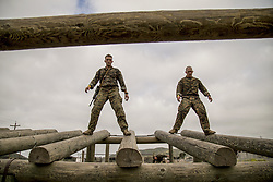 Apr 27, 2017 - Camp Pendleton, California, U.S. - Timber Treaders. Marine Corps Capt. Cameron Heard, left, and Staff Sgt. Michael Birch walk on logs during the inaugural Challenge Reconnaissance at Camp Pendleton, Calif., April 27, 2017. The challenge comprises 24 miles of hiking, helocasting, scout swimming, a memory challenge, obstacle course, live-fire range, close-quarters tactics and two pool stations. Marine Corps photo by Cpl. Brandon Martinez. (Credit Image: © Brandon Martinez/Marines/DoD via ZUMA Wire/ZUMAPRESS.com)