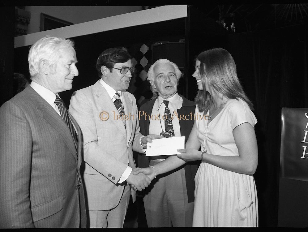 09/08/1979.08/09/1979.9th August 1979.Opening of Irish Patchwork exhibition and Presentation of the Young Designer Awards at Kilkenny Castle. Mr Raphael Burke, T.D., Minister of State at the Department of Industry, Commerce and Energy, presenting the Young Designer Award to Miss Catherine MacAleavey (21), Cabinteely, Dublin at the Kilkenny Castle Design Workshops reception at Kilkenny Castle. Centre is Sir Basil Goulding, Chairman, Kilkenny Design Workshops.