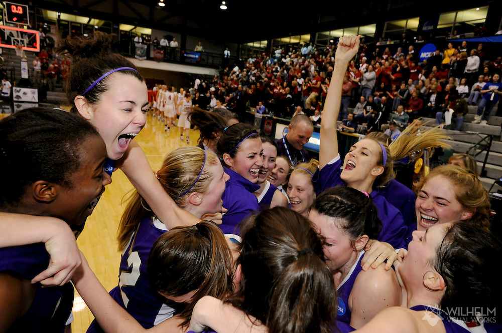 19 MAR 2011:  Amherst College celebrates their victory over University of Washington - St. Louis during the 2011 NCAA Women's Division III Basketball Championship held at the Shirk Center on the campus of the Illinois Wesleyan University in Bloomington, IL. Amherst defeated Washington - St. Louis 64-55 to win the national title. © Brett Wilhelm