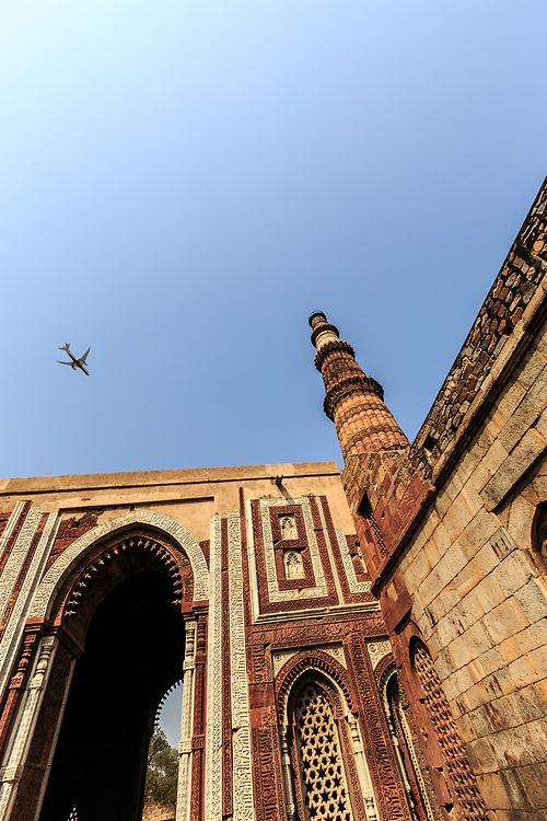 Alai Darwaza or Alai Gate and Qutb Minar in New Delhi, India. This stunning and formidable 72.5 metres tall monument was constructed during the rule of the first Muslim Turkic Sultan named Qutb-ud-din Aibak. Sultan Aibak may have established the Qutub Minar for numerous purposes known only to him and his generation that are being debated even today.