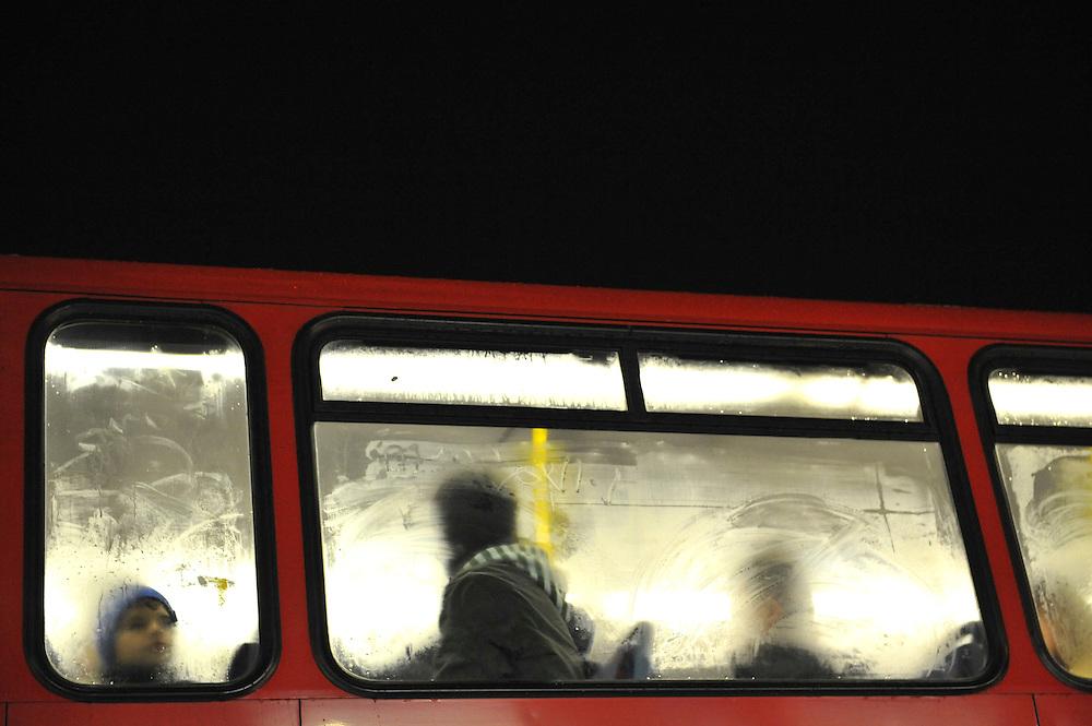 Passengers on a London bus during a rainstorm.