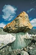 Glacier table, rock perched on pedastal of ice, as surrounding ice ablates away, Sarpo Laggo glacier, Karakoram Mtns, far western China