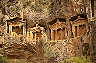 The Hellenistic temple fronted Tombs of Kaunos,  4th - 2nd cent. B.C , just outside the archaeological site of Kounos on the oposite side of the Calbys river from Dalyan, Turkey. Kaunos is on the border of Lycia & Caria and the Kaunos rock tombs differ slightly form Lycian tombs in that the rock surrounding them has been carved away to maje almost free standing temple buildings. .<br /> <br /> If you prefer to buy from our ALAMY PHOTO LIBRARY  Collection visit : https://www.alamy.com/portfolio/paul-williams-funkystock/dalyan-lycian-tombs-and-kaunos.html<br /> <br /> Visit our TURKEY PHOTO COLLECTIONS for more photos to download or buy as wall art prints https://funkystock.photoshelter.com/gallery-collection/3f-Pictures-of-Turkey-Turkey-Photos-Images-Fotos/C0000U.hJWkZxAbg