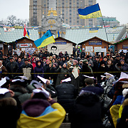 December 19, 2013 - Kiev, Ukraine: Pro-EU demonstrators listen to a activist speech in Independence Square.<br /> On the night of 21 November 2013, a wave of demonstrations and civil unrest began in Ukraine, when spontaneous protests erupted in the capital of Kiev as a response to the government's suspension of the preparations for signing an association and free trade agreement with the European Union. Anti-government protesters occupied Independence Square, also known as Maidan, demanding the resignation of President Viktor Yanukovych and accusing him of refusing the planned trade and political pact with the EU in favor of closer ties with Russia.<br /> After a days of demonstrations, an increasing number of people joined the protests. As a responses to a police crackdown on November 30, half a million people took the square. The protests are ongoing despite a heavy police presence in the city, regular sub-zero temperatures, and snow. (Paulo Nunes dos Santos/Polaris)