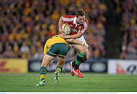 6 July 2013; George North, British & Irish Lions, is tackled by Adam Ashley-Cooper, Australia. British & Irish Lions Tour 2013, 3rd Test, Australia v British & Irish Lions. ANZ Stadium, Sydney Olympic Park, Sydney, Australia. Picture credit: Stephen McCarthy / SPORTSFILE
