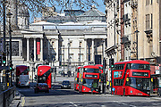 A general view of London Red Buses gathering from the Downing Street looking towards nearly empty Trafalgar Square, Wednesday, March 25, 2020. British lawmakers voted to shut down Parliament for 4 weeks, due to the coronavirus outbreak. The new coronavirus causes mild or moderate symptoms for most people, but for some, especially older adults and people with existing health problems, it can cause more severe illness or death. (Photo/Vudi Xhymshiti)