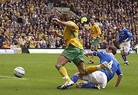 Fotball<br /> England 2004/2005<br /> Foto: SBI/Digitalsport<br /> NORWAY ONLY<br /> <br /> Norwich v Birmingham<br /> FA Barclays Premiership<br /> 07/05/2005<br /> <br /> Norwich's Darren Huckerby is tripped by  Birmingham's Kenny Cunningham for a penalty.