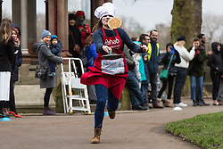 MPs and members of the House of Lords compete in the annual Rehab pancake race, a relay of eleven laps in Victoria Tower Gardens adjacent to the Houses of Parliament in London. The race is held every year on Shrove Tuesday and was won by the Media team. PICTURED: Rachael Venables from LBC Radio. London, February 13 2018.
