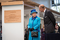 © Licensed to London News Pictures . 14/11/2013 . Manchester , UK . The Queen unveils the official opening plaque with the DofE . Queen Elizabeth II and the Duke of Edinburgh visit the Coop building at 1 Angel Square , Manchester , this morning ( 14th November 2013 ) . Photo credit : Joel Goodman/LNP