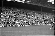 """All Ireland Hurling Final - Cork vs Kilkenny.05.09.1982.09.05.1982.5th September 1982.""""Spot the ball"""" players tussle on the side line watched by the linesman and crowd."""