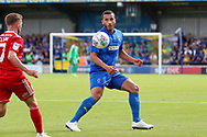 AFC Wimbledon defender Rod McDonald (4) battles for possession with Accrington Stanley midfielder Jordan Clark (7) during the EFL Sky Bet League 1 match between AFC Wimbledon and Accrington Stanley at the Cherry Red Records Stadium, Kingston, England on 17 August 2019.
