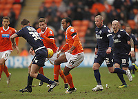 Blackpool's Nathan Delfouneso battles with  Millwall's Sid Nelson<br /> <br /> Photographer Mick Walker/CameraSport<br /> <br /> Football - The Football League Sky Bet Championship - Blackpool v Millwall - Saturday 10th January 2015 - Bloomfield Road - Blackpool <br /> <br /> © CameraSport - 43 Linden Ave. Countesthorpe. Leicester. England. LE8 5PG - Tel: +44 (0) 116 277 4147 - admin@camerasport.com - www.camerasport.com