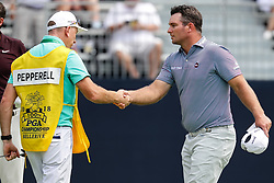 August 9, 2018 - St. Louis, MO, U.S. - ST. LOUIS, MO - AUGUST 09: Ryan Fox (NZL) shakes hands with the caddy of  Eddie Pepperell on the 18th green during Round 1 of the PGA Championship August 9, 2018, at Bellerive Country Club in St. Louis, MO.  (Photo by Tim Spyers/Icon Sportswire) (Credit Image: © Tim Spyers/Icon SMI via ZUMA Press)