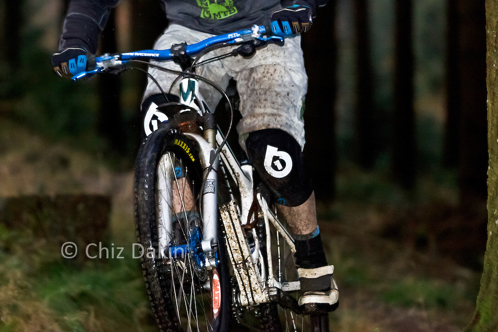 Close-up of Grizedale Mountain bikes staff member descending through forest on the North Face Red Trail in Grizedale Forest.