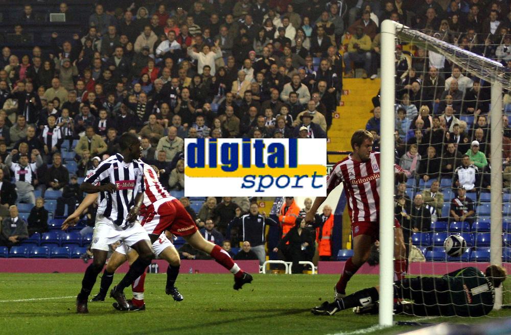 Photo: Mark Stephenson.<br /> West Bromwich Albion v Stoke City. Coca Cola Championship. 03/10/2007.West Brom's v Leon Barnett (L) heads the ball in for 1-1