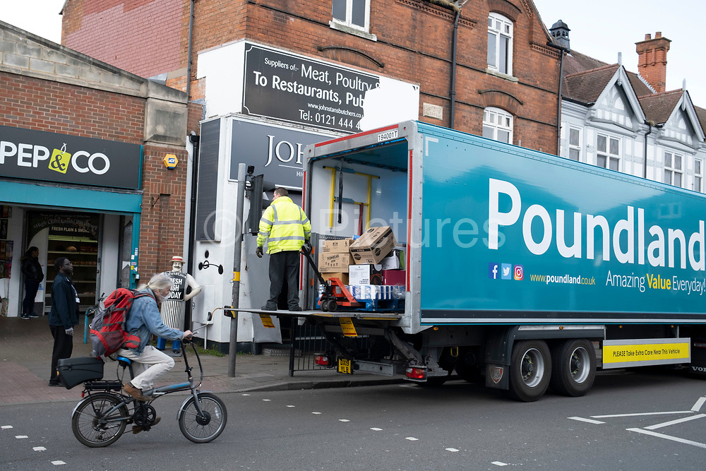 Local response to Coronavirus is felt on a street by street level as Poundland in Kings Heath takes a delivery on 6th April 2020 in Birmingham, England, United Kingdom. Coronavirus or Covid-19 is a new respiratory illness that has not previously been seen in humans. While much or Europe has been placed into lockdown, the UK government has announced more stringent rules as part of their long term strategy, and in particular social distancing.