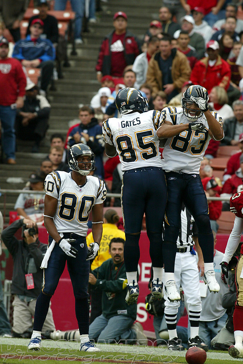 San Diego Chargers receivers Malcom Floyd (80), Antonio Gates (85) and Vincent Jackson (83) celebrate Jackson's touchdown reception against the San Francisco 49ers in the second quarter of an NFL football game, Sunday, Oct. 15, 2006 in San Francisco. The Chargers won, 48-19. (D. Ross Cameron/The Oakland Tribune)