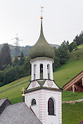 Austria, Tyrol The village of Gerlos, the church belfry and clock tower