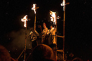 The Archbishop and bishops on the podium, surrounded by burning crosses at Cliffe Bonfire, Lewes 5/11/05