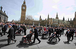 File photo dated 10/05/15 showing veterans taking part in the VE Day Parade to mark the 70th anniversary of VE Day, at Parliament Square in London, celebrating VE (Victory in Europe) Day in London, marking the end of the Second World War in Europe now 75 years ago.