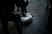 Momenti di tensione tra manifestanti e forze dell'ordine durante il corteo organizzato dai movimenti per il diritto alla casa contro le politiche di austerita', Roma 12 Aprile 2014.  Christian Mantuano / OneShot <br /> <br /> Clashes between police and protesters during an anti-austerity march in Rome, April 12, 2014. Christian Mantuano / OneShot
