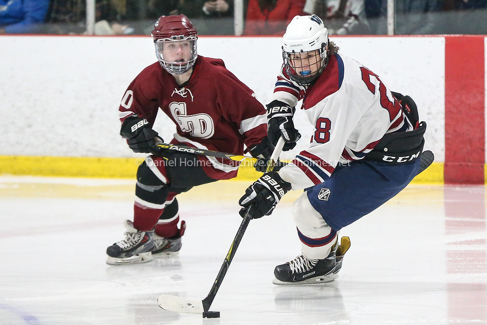 (3/2/19, WESTBOROUGH, MA) Westborough's Jack Board  takes the puck up the ice during the  quarterfinals of the Division 3 Boys hockey playoffs against Groton-Dunstable at NorthStar Ice Rink in Westborough on Saturday. [Daily News and Wicked Local Photo/Dan Holmes]