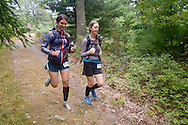 Kerhonkson, New York - Jenna Tomiello, left, and Laura Merner move through Minnewaska State Park Preserve during the Shawangunk Ridge Trail Run/Hike 20-mile race on Sept. 20, 2014.
